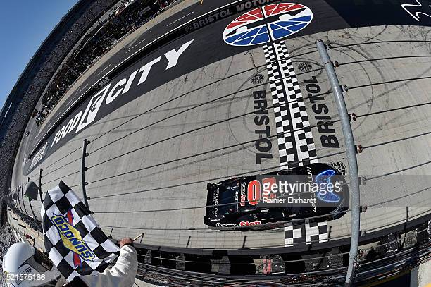 Erik Jones driver of the Gamestop/Performance Designed Products Toyota takes the checkered flag to win the NASCAR XFINITY Series Fitzgerald Glider...