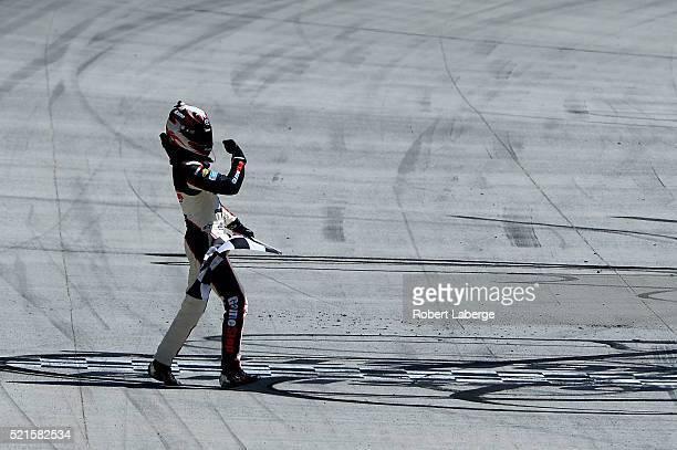 Erik Jones, driver of the Gamestop/Performance Designed Products Toyota, celebrates winning the NASCAR XFINITY Series Fitzgerald Glider Kits 300 at...