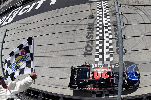 Erik Jones, driver of the Gamestop/Performance Designed Products Toyota, takes the checkered flag to win the NASCAR XFINITY Series Fitzgerald Glider...