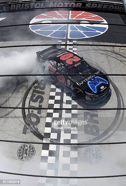 Erik Jones, driver of the Gamestop/Performance Designed Products Toyota, celebrates with a burnout after winning the NASCAR XFINITY Series Fitzgerald...
