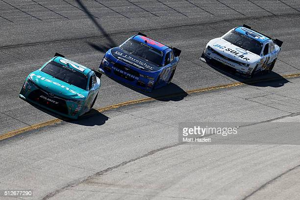 Erik Jones driver of the Hisense USA Toyota leads Jeb Burton driver of the J Streicher Ford and Brennan Poole driver of the DC Solar Chevrolet during...