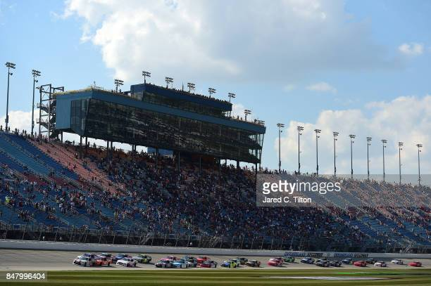 Erik Jones driver of the NBA 2K18/GameStop Toyota and Daniel Suarez driver of the Comcast Business/Juniper Toyota lead the field to turn one after...