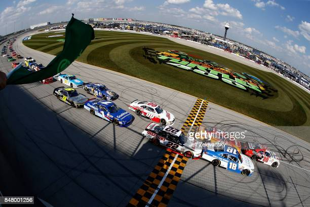 Erik Jones driver of the NBA 2K18/GameStop Toyota and Daniel Suarez driver of the Comcast Business/Juniper Toyota lead the field to the green flag to...