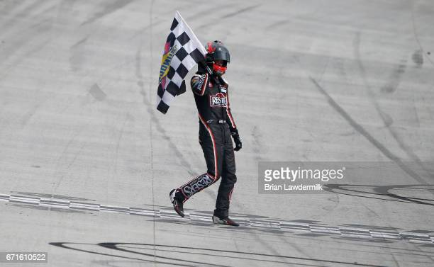 Erik Jones, driver of the Reser's American Classic Toyota, celebrates with the checkered flag after winning the NASCAR XFINITY Series Fitzgerald...