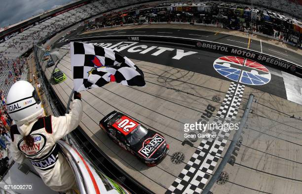 Erik Jones driver of the Reser's American Classic Toyota crosses the finish line to win the NASCAR XFINITY Series Fitzgerald Glider Kits 300 at...