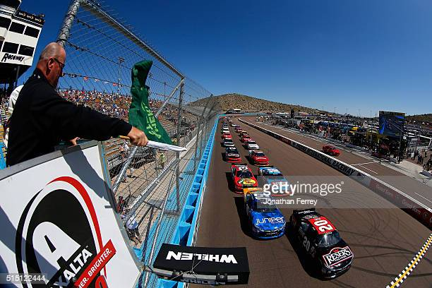 Erik Jones, driver of the Reser's Fine Foods Toyota, and Daniel Suarez, driver of the Juniper Networks Toyota, lead the field to the green flag at...