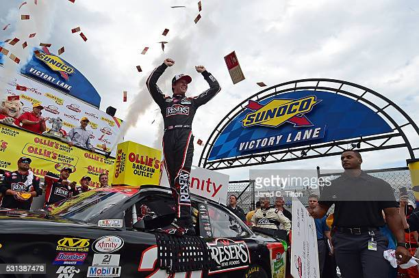 Erik Jones driver of the Reser's Fine Foods Toyota celebrates in Victory Lane after winning the NASCAR XFINITY Series Ollie's Bargain Outlet 200 at...
