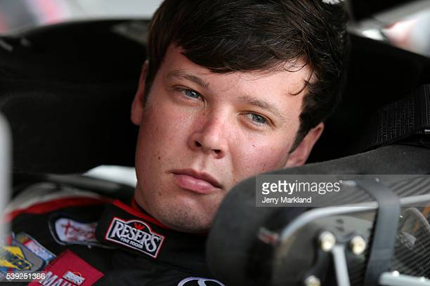 Erik Jones driver of the Reser's Fine Foods Toyota sits in his car during practice for the NASCAR XFINITY Series Menards 250 at Michigan...