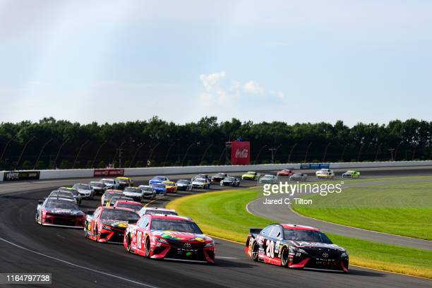 Erik Jones driver of the Reser's Main St Bistro Toyota leads the field during the Monster Energy NASCAR Cup Series Gander RV 400 at Pocono Raceway on...