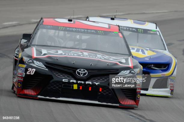Erik Jones driver of the Reser's Toyota leads Chase Elliott driver of the NAPA Auto Parts Chevrolet during the Monster Energy NASCAR Cup Series...