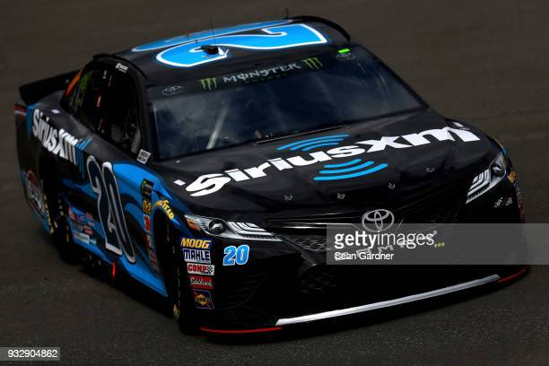 Erik Jones driver of the SiriusXM Toyota drives in the garage area during practice for the Monster Energy NASCAR Cup Series Auto Club 400 at Auto...