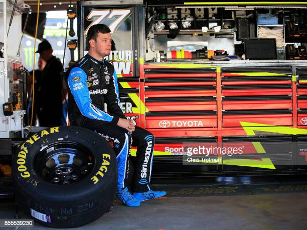 Erik Jones driver of the SiriusXM Toyota sits in the garage area during practice for the Monster Energy NASCAR Cup Series Apache Warrior 400...