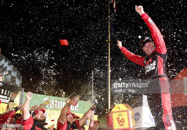 Erik Jones driver of the Sport Clips Throwback Toyota celebrates in Victory Lane after winning the Monster Energy NASCAR Cup Series Bojangles'...
