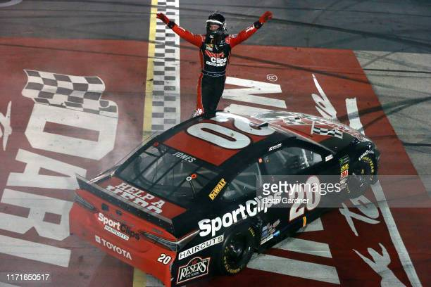 Erik Jones driver of the Sport Clips Throwback Toyota celebrates after winning the Monster Energy NASCAR Cup Series Bojangles' Southern 500 at...