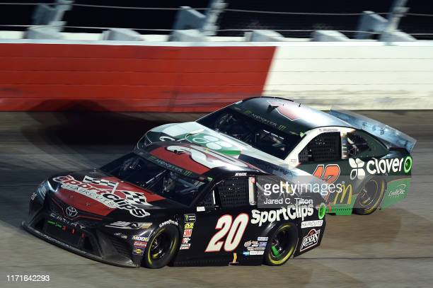 Erik Jones driver of the Sport Clips Throwback Toyota races Kyle Larson driver of the Clover Chevrolet during the Monster Energy NASCAR Cup Series...