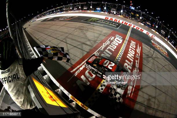 Erik Jones driver of the Sport Clips Throwback Toyota takes the checkered flag to win the Monster Energy NASCAR Cup Series Bojangles' Southern 500 at...