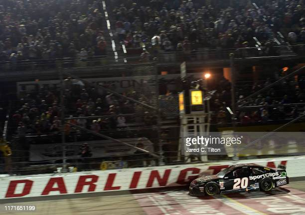 Erik Jones driver of the Sport Clips Throwback Toyota wins the Monster Energy NASCAR Cup Series Bojangles' Southern 500 at Darlington Raceway on...