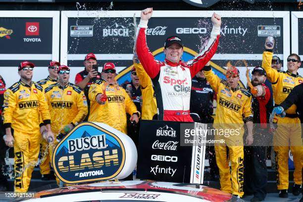 Erik Jones driver of the Sport Clips Toyota celebrates in Victory Lane after winning the NASCAR Cup Series Busch Clash at Daytona International...