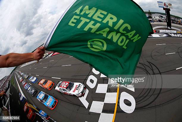 Erik Jones driver of the SportClips Haircuts Toyota and Kyle Busch driver of the NOS Energy Drink Toyota lead the field to the green flag to start...