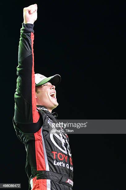 Erik Jones, driver of the Toyota, celebrates after winning the series championship after the NASCAR Camping World Truck Series Ford EcoBoost 200 at...