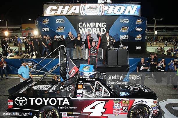 Erik Jones, driver of the Toyota, celebrates in victory lane after winning the series championship during the NASCAR Camping World Truck Series Ford...