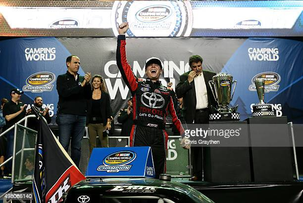 Erik Jones driver of the Toyota celebrates winning the series championship after the NASCAR Camping World Truck Series Ford EcoBoost 200 at...