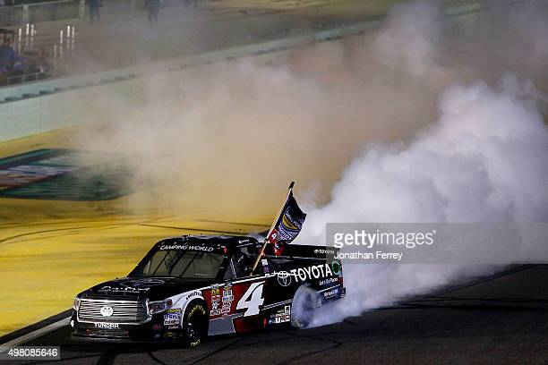 Erik Jones, driver of the Toyota, celebrates with a burnout after winning after winning the series championship after the NASCAR Camping World Truck...