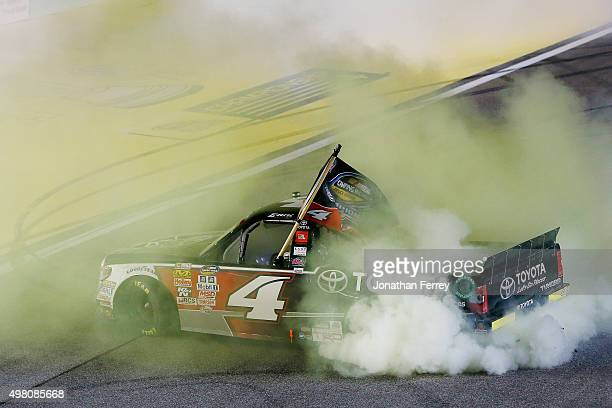 Erik Jones driver of the Toyota celebrates with a burnout after winning after winning the series championship after the NASCAR Camping World Truck...