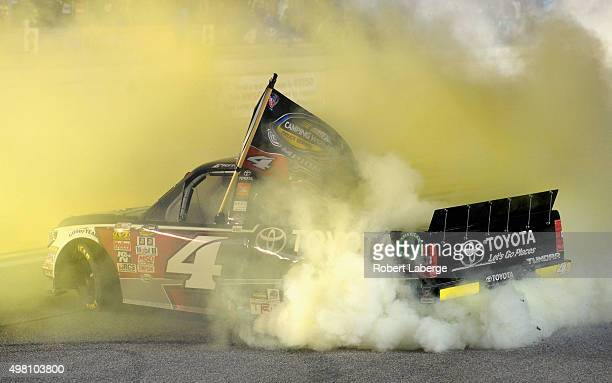 Erik Jones, driver of the Toyota, celebrates with a burnout after winning the series championship during the NASCAR Camping World Truck Series Ford...