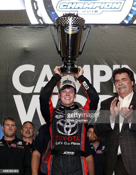 Erik Jones, driver of the Toyota, celebrates with the trophy after winning the series championship after the NASCAR Camping World Truck Series Ford...