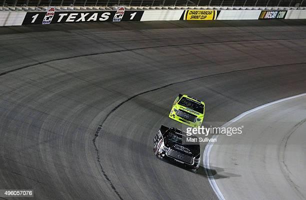 Erik Jones driver of the Toyota leads Matt Crafton driver of the Damp Rid/Menards Toyota during the NASCAR Camping World Truck Series WinStar World...