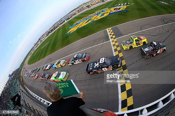 Erik Jones driver of the Toyota Toyota and Matt Crafton driver of the Slim Jim/Menards Toyota lead the pack at the start of the NASCAR Camping World...