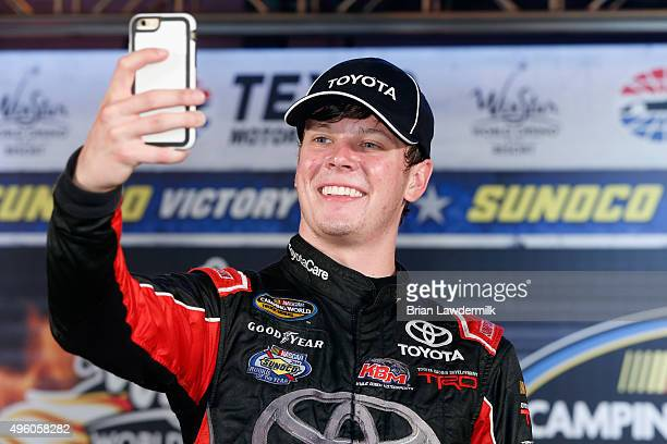 Erik Jones driver of the Toyota Toyota celebrates in victory lane with a selfie photograph after winning the NASCAR Camping World Truck Series...