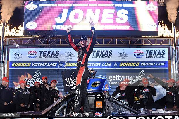 Erik Jones driver of the Toyota Toyota celebrates in victory lane after winning the NASCAR Camping World Truck Series WinStar World Casino 350 at...