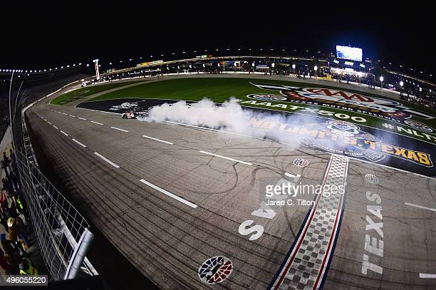 Erik Jones driver of the Toyota Toyota celebrates with a burnout after winning the NASCAR Camping World Truck Series WinStar World Casino 350 at...