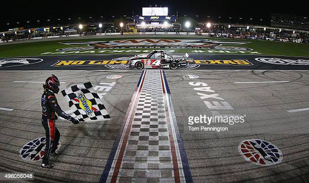 Erik Jones driver of the Toyota Toyota celebrates with the checkered flag after winning the NASCAR Camping World Truck Series WinStar World Casino...
