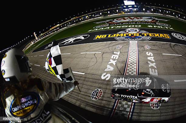 Erik Jones driver of the Toyota Toyota takes the checkered flag to win the NASCAR Camping World Truck Series WinStar World Casino 350 at Texas Motor...