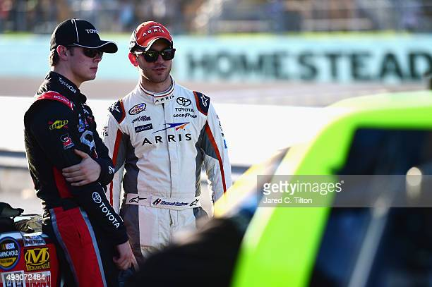 Erik Jones driver of the Toyota Toyota talks to Daniel Suarez driver of the ARRIS Toyota on the grid during qualifying for the NASCAR Camping World...
