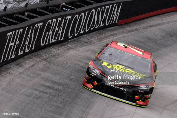 Erik Jones Furniture Row Racing Toyota Camry drives through the middle of turns one and two during practice for the Bass Pro Shops NRA Night Race on...