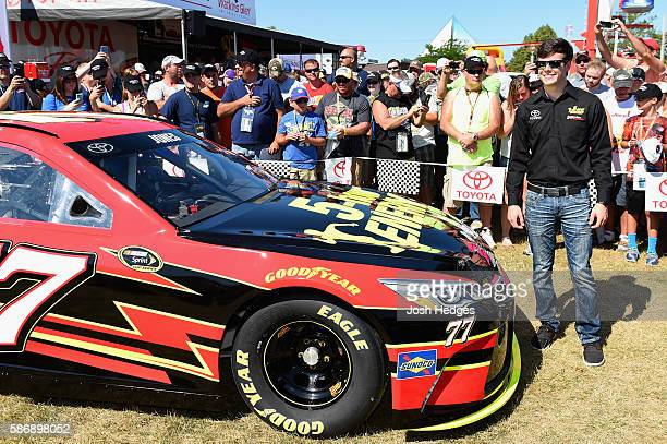 Erik Jones poses with his car after announcing he will drive the 5 hour Energy Toyota for Furniture Row Racing in 2017 prior to the NASCAR Sprint Cup...