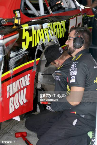 Erik Jones's crew fixes damage during practice for the Ford Ecoboost 400 at HomesteadMiami Speedway on November 18 2017 in Homestead Florida
