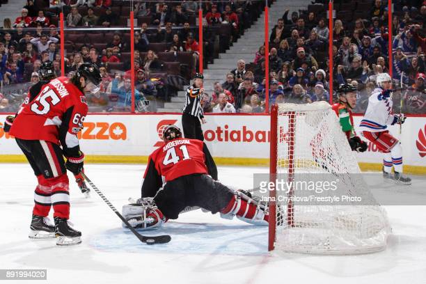 Erik Karlsson and Craig Anderson of the Ottawa Senators react after a third period goal scored by Pavel Buchnevich of the New York Rangers at...