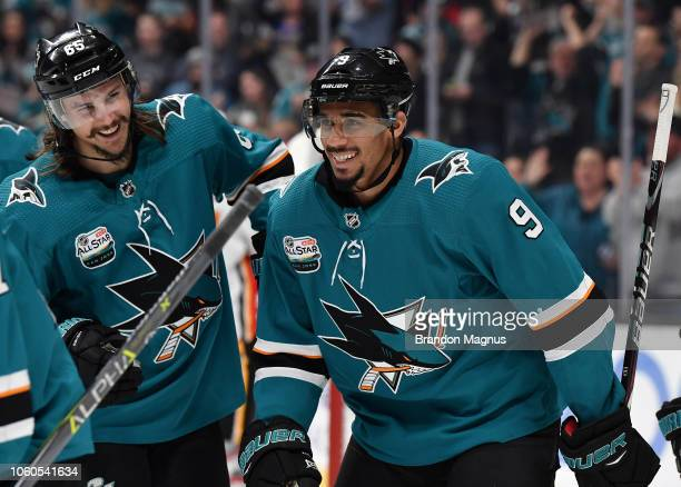 Erik Karlsson and Evander Kane of the San Jose Sharks celebrate scoring a goal against the Calgary Flames at SAP Center on November 11 2018 in San...