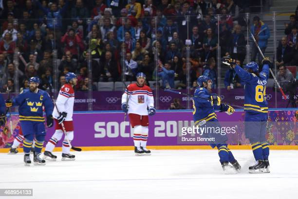 Erik Karlsson of Sweden celebrates with teammate Oliver Ekman Larsson after scoring a goal in the first period against Jakub Kovar of Czech Republic...