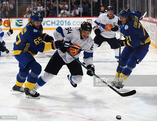 Erik Karlsson of Sweden is challenged by Mikael Graulund of Finland during the World Cup of Hockey game between Finland and Sweden at the Hartwell...