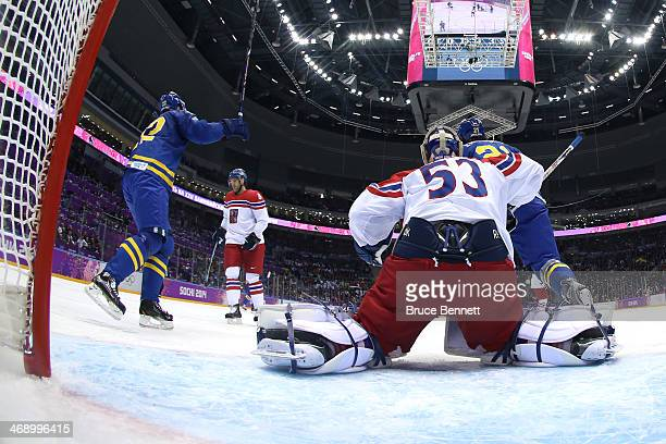 Erik Karlsson of Sweden scores a goal in the second period against Alexander Salak of Czech Republic during the Men's Ice Hockey Preliminary Round...