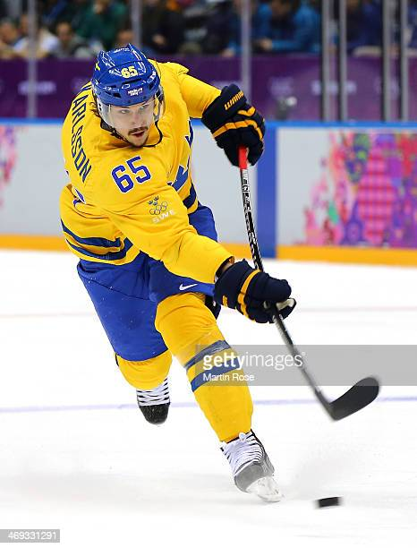 Erik Karlsson of Sweden shoots in the second period against Switzerland during the Men's Ice Hockey Preliminary Round Group C game on day seven of...