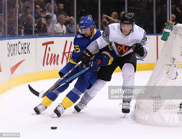 Erik Karlsson of Team Sweden battles for the puck with Ryan NugentHopkins of Team North America during the World Cup of Hockey 2016 at Air Canada...