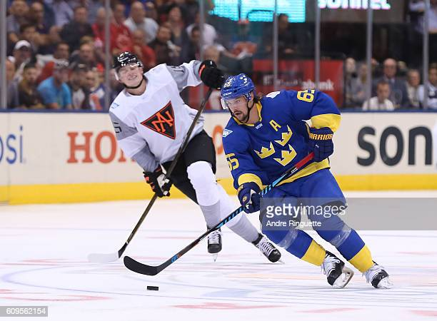 Erik Karlsson of Team Sweden stickhandles the puck with Jack Eichel of Team North America chasing during the World Cup of Hockey 2016 at Air Canada...