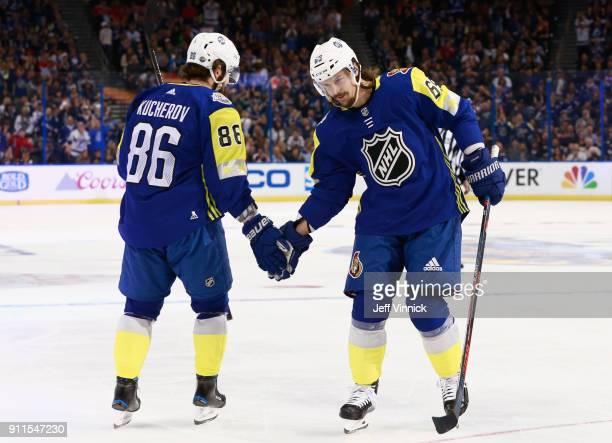 Erik Karlsson of the Ottawa Senators and Nikita Kucherov of the Tampa Bay Lightning celebrate during the 2018 Honda NHL AllStar Game between the...
